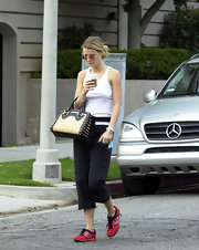 Gywneth spiced up her casual attire with a leather studded handbag and red shoes.