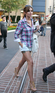 Cheryl looked summer chic in a plaid top with white shorts and tan leather wedges.