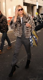 Kate Moss added a touch of boho flair to her sophisticated jumpsuit with this fur coat.