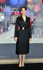 Marion looked like a vintage beauty in her belted black coat dress at the Christmas display lighting.