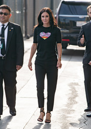 Courteney Cox teamed her shirt with basic black slacks.