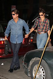 Katie rocks one of the summer's hottest celebrity trends: the plaid boyfriend shirt.
