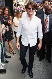 Tom wore a pale blue, striped, button down shirt—perfect for the sunny spring day.