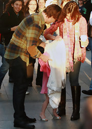 Suri Cruise has fun playing dress up in these silver kitten heels.