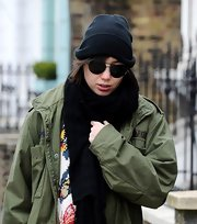Daisy Lowe bundled up with a black knit beanie while out walking her dog in London.