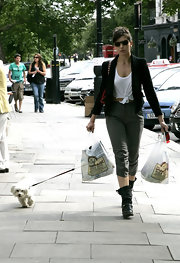 Daisy rocked a pair of high-waisted pants with a cropped tee and combat boots while walking her pup.