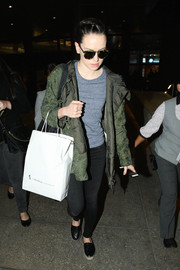Daisy Ridley was spotted at LAX looking laid-back in a green windbreaker layered over a gray tee.