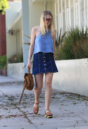 Dakota Fanning teamed her top with a denim mini skirt by Alexa Chung for AG.