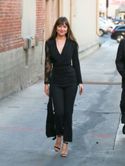 Dakota Johnson looked effortlessly elegant in a black lace-sleeve jumpsuit by Givenchy as she left 'Kimmel.'