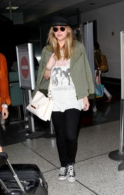 Dakota Johnson teamed her jacket with black skinny jeans and an old tee.