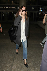 Dakota Johnson kept it laid-back in a pair of ripped jeans.