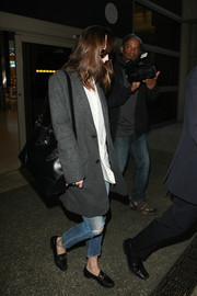 This large black cross-body tote by Alexander McQueen looked perfect for Dakota Johnson's jet-setting lifestyle!