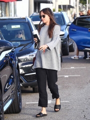 Dakota Johnson sealed off her casual look with black slide sandals by Isabel Marant.