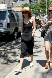 Dakota Johnson cut a super-slim figure in her spaghetti-strap LBD while out on a stroll.