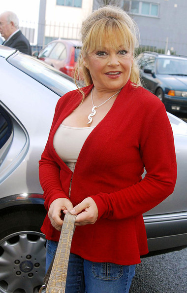 Charlene Tilton donned a hot red blazer while out with 'Dallas' stars at the Museum of Style Icons.