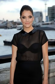 Julie Gonzalo looked cute and sexy in a sheer black blouse with a Peter Pan collar during the launch of 'Dallas' in London.