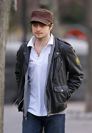 Daniel showed off his casual side in a brown military cap, which he paired with a leather jacket.