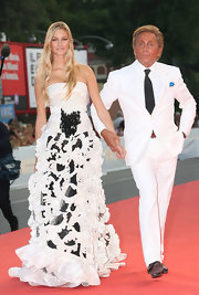 Beatrice Borromeo looked breathtaking on the arm of Valentino Garavani in his black-and-white evening gown with a fitted bodice and full ruffled skirt.