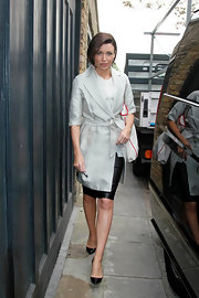 Danni Minogue wears a dove gray trench coat while out in London.