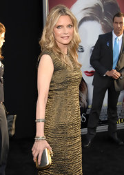 Michelle Pfeiffer completed her shimmery ensemble with layers of diamond-studded bangles when she attended the 'Dark Shadows' premiere.