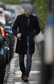 David Beckham always keeps it classy, especially in a solid black wool coat as seen here during a stroll in London.