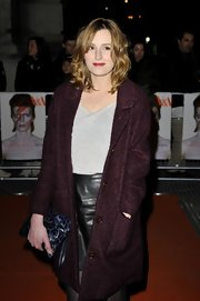 Laura Carmichael carried a blue leopard printed clutch at the 'David Bowie Is' event.