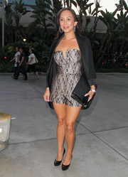Cheryl Burke topped off her cute romper with a black tux jacket.