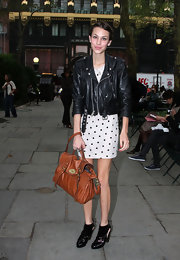 "Never one to forget her ""Alexa"" bag, the TV host and radio personality is seen outside Bryant Park in a polka-dot-pretty dress, leather coat and her favorite ankle boots."