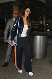 Deepika Padukone caught a flight looking hip in a shiny cropped jacket.