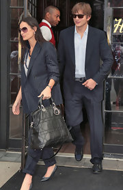 Demi Moore wore a pinstripe suit with cuffed slacks.