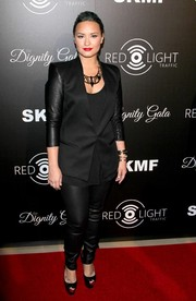 Demi Lovato was edgy-stylish in a black Helmut Lang blazer with leather sleeves at the Redlight Traffic Dignity Gala.