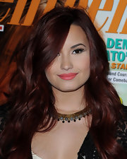 Demi Lovato added a pop of pretty warm pink lip color for her 'Seventeen' cover signing.