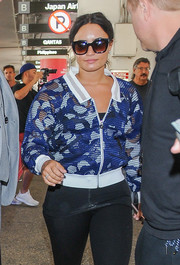 Demi Lovato kept her eyes hidden behind a pair of butterfly sunnies as she arrived on a flight at LAX.