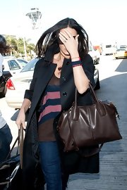 Demi Moore carried a large brown leather tote for her trip to LAX with Ashton Kutcher.