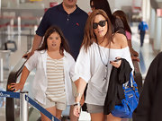 Demi accessorized her oversize white tee with a black rosary necklace and a long silver chain.