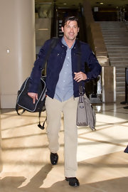 Patrick Dempsey looked casually cool in a navy blue zip up jacket.