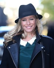 Denise van Outen wore a classic black fedora while out at the London studios.
