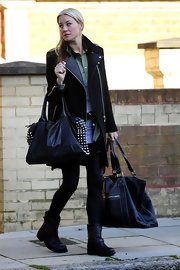 Denise van Outen looked great in a leather coat as she was seen leaving her North London home.