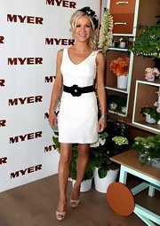 Danielle Spencer looked classy in this white cocktail dress with an adorned black belt.