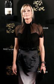 Bo Derek looks phenom in this sheer fitted black blouse with lovely gathering.