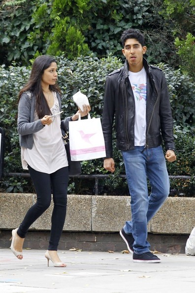 Dev Patel is sporting a leather jacket around town with his main squeeze. A must-have for any guy's closet.