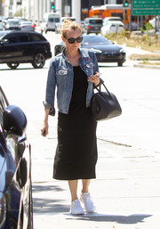 Diane Kruger looked easy-breezy in a Madewell denim jacket layered over a little black dress while out and about in LA.