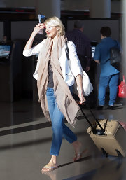 Cameron Diaz walked through LAX on her way to catch a flight while wearing a pair of silver thongs.
