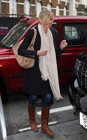 Cameron keeps warm in winter with an extra long soft cream scarf.