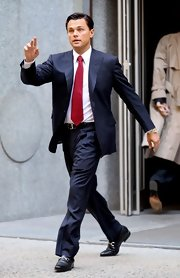 Leonardo DiCaprio's striped navy suit and red tie on the set of 'The Wolf of Wall Street' were a handsome combination.