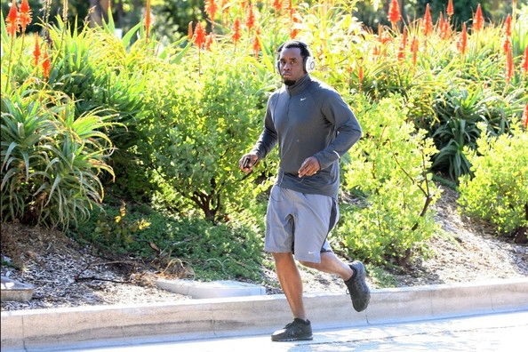 Sean Combs went out for a run in Coldwater Canyon wearing gray Nike shorts and a half-zip sweater.