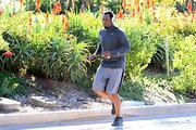 Sean Combs chose a gray Nike half-zip sweater and shorts for his exercise get-up.