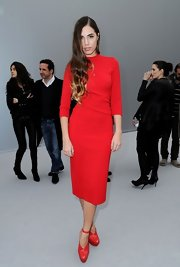 Amber Le Bon went all red at the Dior Fashion Show as she matched her dress with a pair of red platform pumps.
