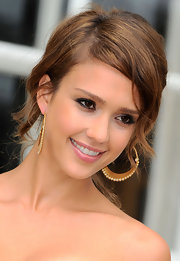 Jessica Alba paired her loose bun with gold hoop earrings.