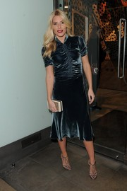Mollie King worked a vintage vibe at the Dior pop-up launch party in a blue velvet frock with a ruched bodice.